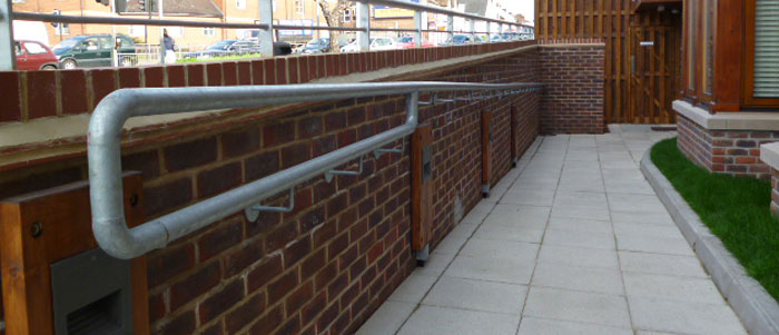 Disabled entrance with slope and handrail